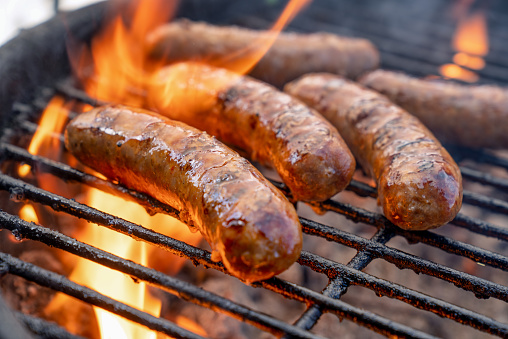 Barbecue Grill「Hot Delicious Bratwurst or Brats on a fiery grill almost ready to eat」:スマホ壁紙(16)