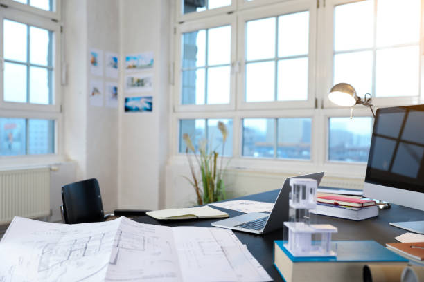Desk with construction plan in a modern informal office:スマホ壁紙(壁紙.com)