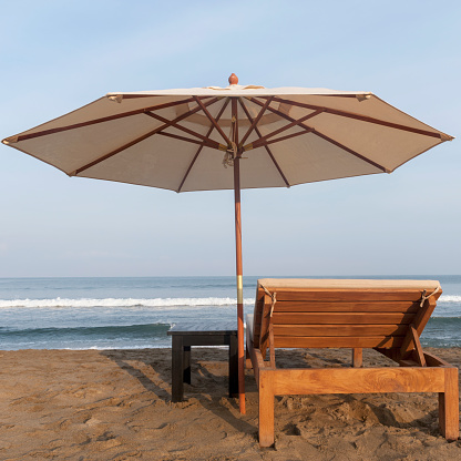 Sayulita「A lounge chair and umbrella on the beach at the water's edge; sayulita mexico」:スマホ壁紙(15)