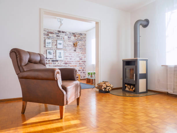 Germany, modern living room, leather chair and fireplace:スマホ壁紙(壁紙.com)