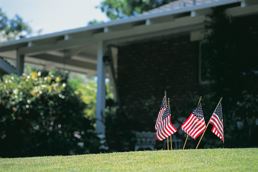 Fourth of July「Four Small Stars and Stripes Flags Stuck in a Garden Lawn」:スマホ壁紙(12)