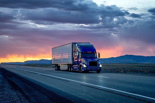 Struggle「Heavy Hauler Semi-Trailer Tractor Truck Speeding Down a Four-Lane Highway with a Dramatic and Colorful Sunset or Sunrise In the Background」:スマホ壁紙(19)