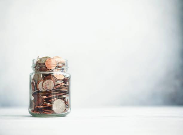 Change Jar Filled with Coins on Gray Background:スマホ壁紙(壁紙.com)