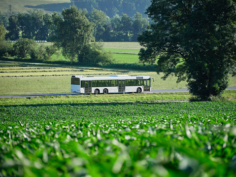 Focus On Background「Bus moving on highway along green field」:スマホ壁紙(18)