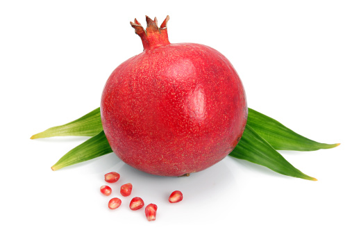 Grenadines「Pomegranate fruit with green leaf and seeds isolated」:スマホ壁紙(3)