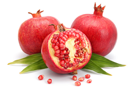 Grenadines「Pomegranate fruits with green leaf and cuts isolated」:スマホ壁紙(4)