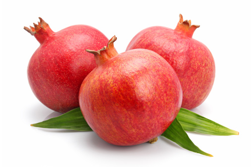Grenadines「Pomegranate fruits with green leaf isolated」:スマホ壁紙(2)