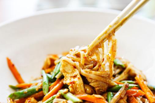 Fusion Food「Chopsticks taking food from dish of stir fried Thai chicken」:スマホ壁紙(4)