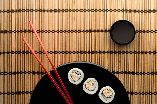 Soy Sauce「Chopsticks and sushi on round plate with dipping sauce」:スマホ壁紙(1)