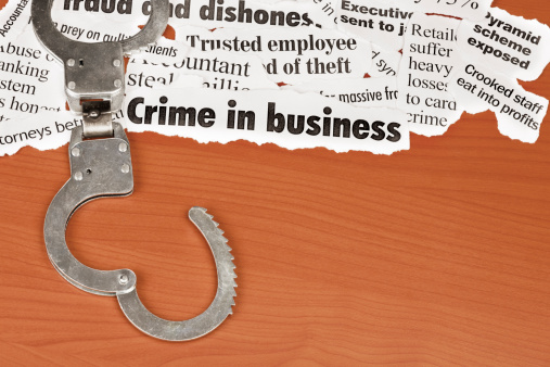 Emergency Services Occupation「Open handcuffs next to headlines about business crime on desk」:スマホ壁紙(5)