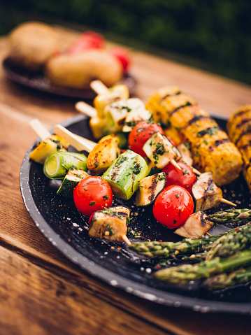 Barbecue Grill「Barbecue grilled vegetable kebabs, corn and asparagus on a plate」:スマホ壁紙(11)