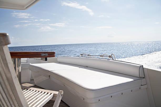 Italy, Sardinia, Chair on yacht deck:スマホ壁紙(壁紙.com)