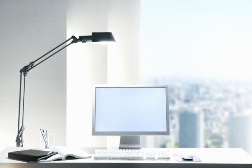 Desk Lamp「Desk lamp and computer on desk with view of a city through the window」:スマホ壁紙(9)