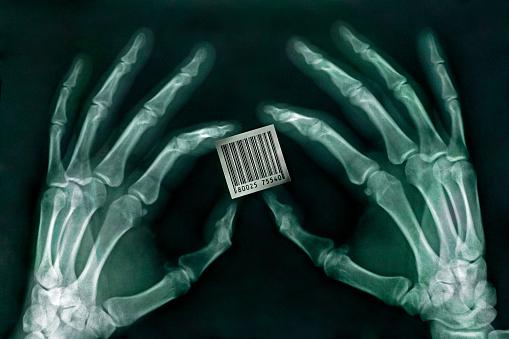 Bone「Skeletal Hands Holding Barcode」:スマホ壁紙(1)