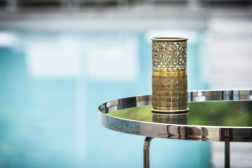 北アフリカ「Morocco, Fes, Hotel Riad Fes, tea light holder on side table near the pool」:スマホ壁紙(4)
