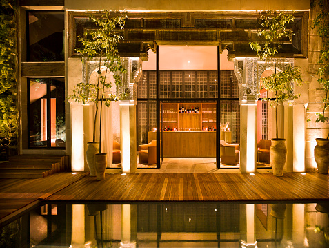 Morocco「Morocco, Fes, Hotel Riad Fes, courtyard with swimming pool by night」:スマホ壁紙(8)