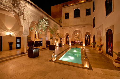 Morocco「Morocco, Fes, Hotel Riad Fes, courtyard with lightened pool by night」:スマホ壁紙(14)