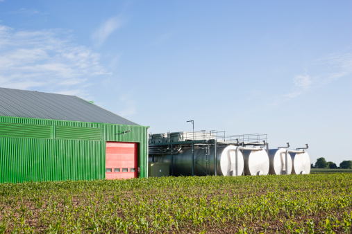 Specimen Holder「Tanks outside warehouse in rural landscape」:スマホ壁紙(0)