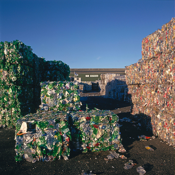 Bale「Bales of plastic bottles stacked in storage yard ready for recycling.」:写真・画像(12)[壁紙.com]