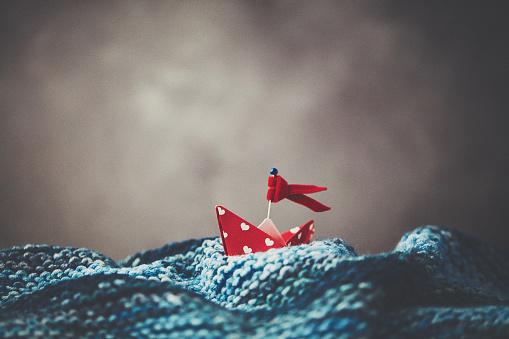 Paper Craft「Handmade origami love boat on handmade waves with stormy skies」:スマホ壁紙(6)