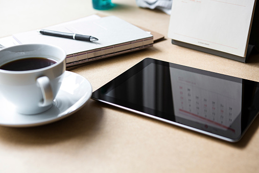 Internet「Tablet computer on table with book and coffee」:スマホ壁紙(1)