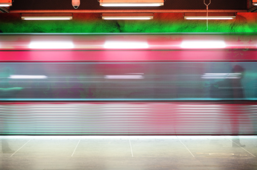 Rush Hour「Brightly lit colorful subway train seen from side」:スマホ壁紙(19)