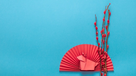 Festival of Japan「Chinese New Year Ornament. Chinese Zodiac Sign Year of OX. Red artificial plum blossom, origami paper semicircle and pig symbol of 2021 on blue background, free space for text, minimalism.」:スマホ壁紙(8)