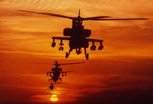 Military「Four AH-64 Apache anti-armor helicopters fly in formation at dusk.」:スマホ壁紙(10)