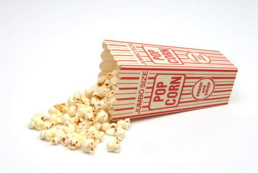 Spilling「Popcorn spilling from red and white popcorn box-isolated on white」:スマホ壁紙(12)