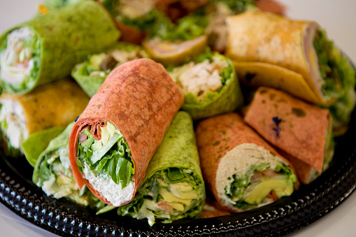 Tortilla - Flatbread「Black tray full of rolled sandwiches with colored tortillas」:スマホ壁紙(6)