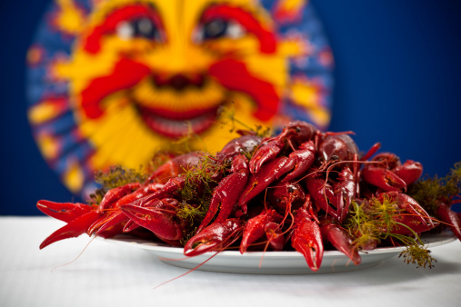 Swedish Culture「Many colorful crayfish on a plate with dill, blue background」:スマホ壁紙(19)