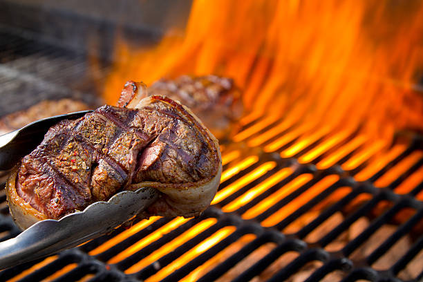 Bacon Wrapped Beef Filet Mignon on Grill with Dancing Flames:スマホ壁紙(壁紙.com)