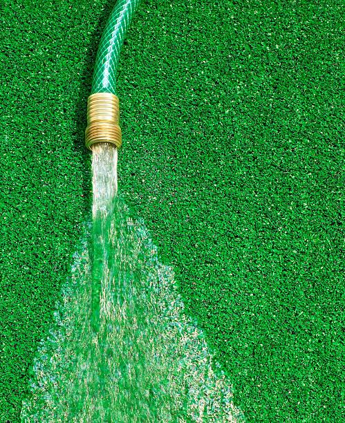 Hose running water on artificial grass:スマホ壁紙(壁紙.com)