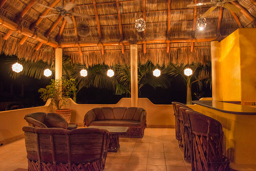 Nayarit「Sofas and chairs with bar on outdoor patio at night」:スマホ壁紙(15)