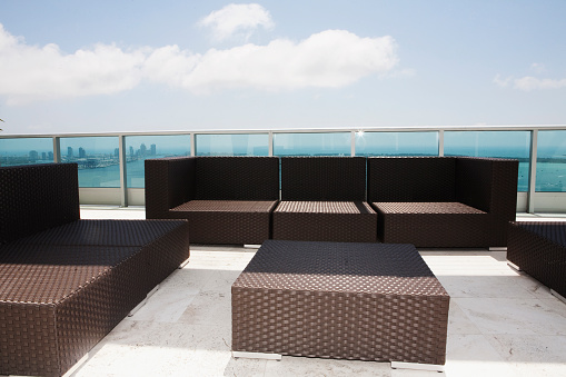 Gulf Coast States「Sofas and coffee table on modern patio」:スマホ壁紙(1)