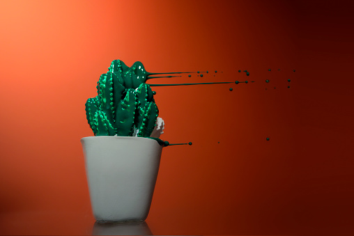 Red Background「Cactus model with green paint blowing off it」:スマホ壁紙(16)