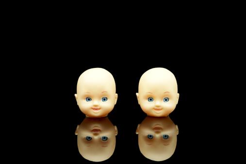 Doll「Two plastic doll heads on a black background」:スマホ壁紙(4)