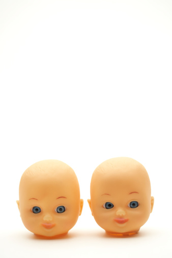 Doll「Two plastic doll heads on a white background」:スマホ壁紙(3)
