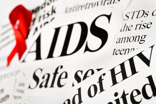 Teenager「Red awareness ribbon on AIDS related newspaper headlines」:スマホ壁紙(4)