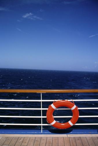 Cruise - Vacation「Flotation ring on railing of ship」:スマホ壁紙(1)