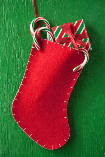 Green Background「Christmas stocking with gift and candy canes」:スマホ壁紙(10)