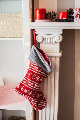 Christmas「Christmas stocking hanging on fireplace」:スマホ壁紙(5)