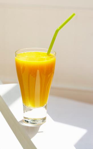 Orange juice「Glass of orange juice with green bendy straw, close up」:スマホ壁紙(12)