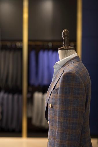 Formalwear「Suits on display in menswear shop」:スマホ壁紙(8)