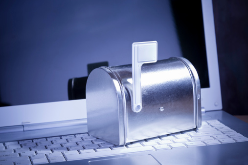 Receiving「You've Got Mail. Miniature silver mailbox on white laptop.」:スマホ壁紙(9)