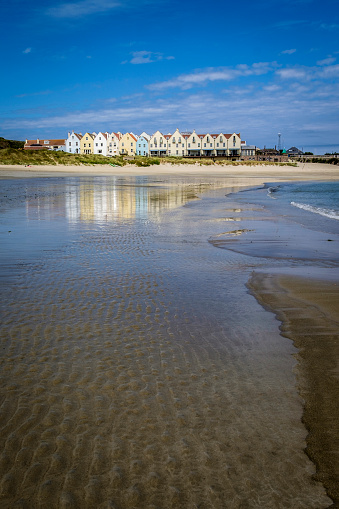 Rippled「Row of houses and a hotel, reflected in the water at Braye Beach, Alderney, Guernsey, Channel Islands」:スマホ壁紙(9)