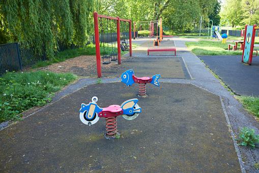Motorcycle「UK, England, London, Seesaws in empty playground」:スマホ壁紙(14)