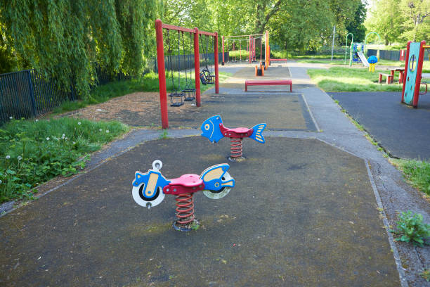 UK, England, London, Seesaws in empty playground:スマホ壁紙(壁紙.com)