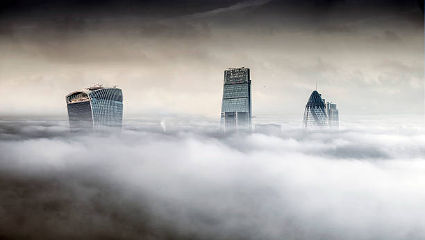 London city towers rising over fog:スマホ壁紙(壁紙.com)