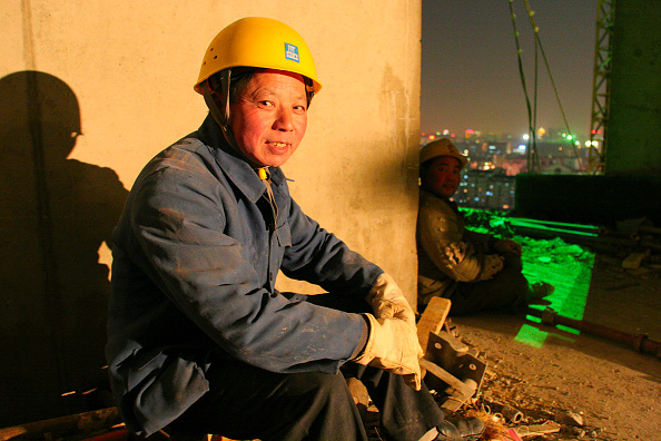 Economy「A night shift working on a high rise office block in central Beijing.」:写真・画像(6)[壁紙.com]